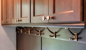 Coat hooks under cabinets