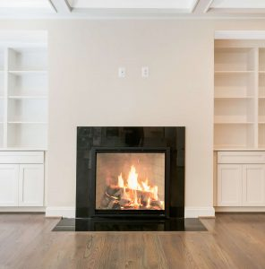 Fireplace with custom built-in shelving