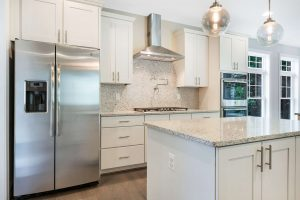 Kitchen island and stainless steel refrigerator