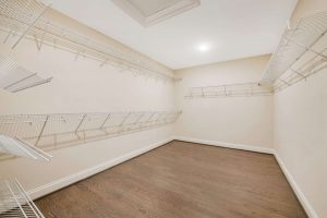 Large walk-in closet with shelving