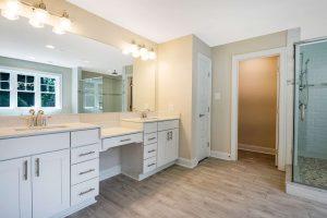 Bathroom vanity with granite countertop and dual sinks
