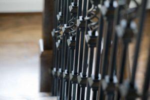 Closeup of iron stairway posts