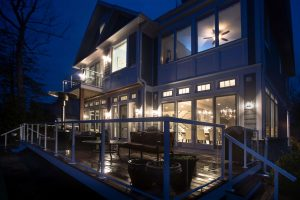 Deck illuminated at night by exterior lighting