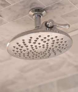 Shower head mounted to ceiling