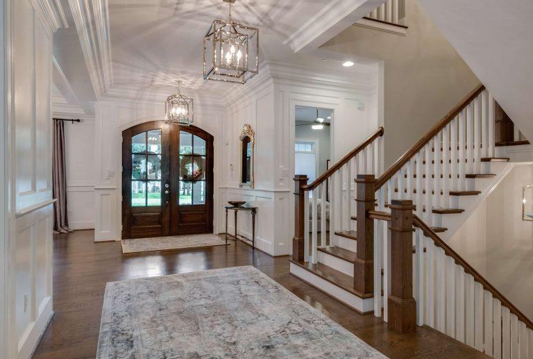 A foyer/entryway with hardwood flooring